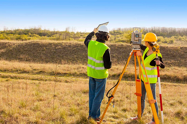 Land Surveyors looking at landscape